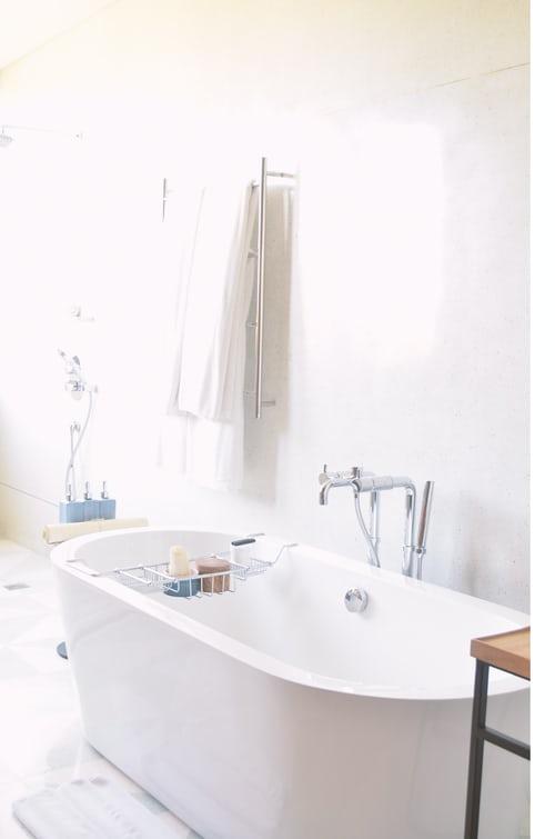 A beautifully reglazed bathtub with silver tap and caddy