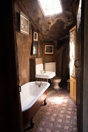 A bathroom with brown accents and decor