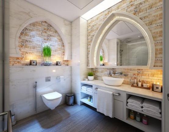A bathroom with wood-like tiles on the floor