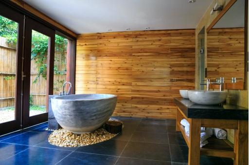 A freestanding bathtub design installed in a bathroom