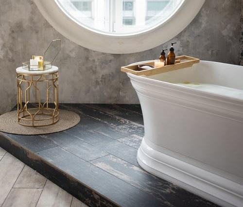 A modern bathroom with a statement bathtub