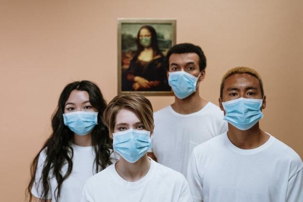 Four people wearing masks