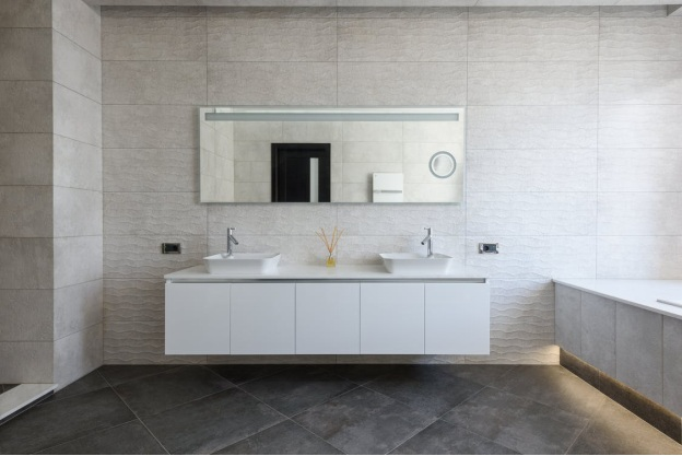 a white bathroom vanity after a bathroom renovation in New York