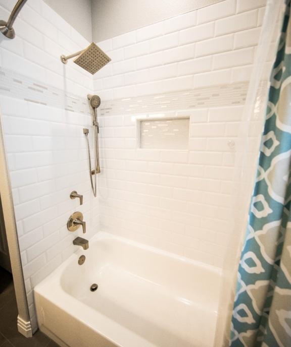 A shower merged with a bathtub