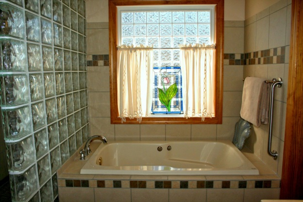 A bathtub with a window in the background