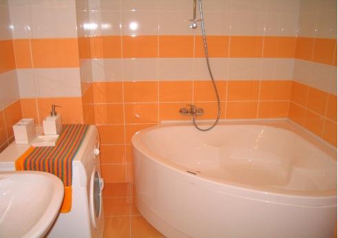 An orange-themed bathroom