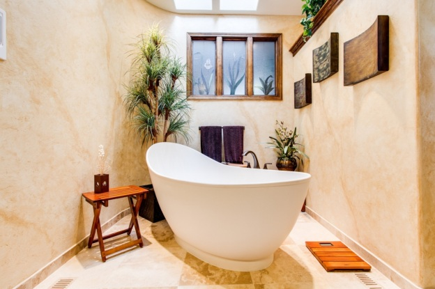 Modern bathroom with a bathtub that's been refinished